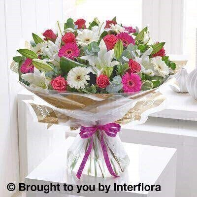 Pink and white Flowers – Bouquet in a Box <br><br> Liverpool Flower Delivery<br><br> We offer advanced booking flower delivery same day flower delivery 3 hour Flower delivery guaranteed AM PM or Evening Flower Delivery and we are now offering Sunday Flower Delivery. .<br><br> <ul><li>Hand arranged by our florists</li><li> To give the best occasionally we may make substitutes</li><li> Our flowers backed by our 7 days freshness guarantee</li><li> Approximate dimensions 52x55cm</li><li> This product is available for delivery throughout the UK</li></ul><br><br>  THIS PRODUCT COMES HAND ARRANANGED AND GIFT WRAPPED IN A WATER BUBBLE PRESENTED IN A BOX This design is all about contrast. The rich shades of hot pink and cerise look stunning with pristine white and lush green. Notice too  the lovely contrast between the smooth star-shaped lily petals  the classic rose blooms and the cheery circular germini flowers. A gorgeous gift.<br><br>  Featuring cerise germini  white Oriental lilies  cerise large headed roses and white germini  with folded aspidistra leaves  eucalyptus  salal and pittosporum  wrapped and trimmed with a Happy Birthday ribbon.<br><br> The best florist in Liverpool<b><b>Come to Booker Flowers and Gifts Liverpool for your Beautiful Flowers and Plants if you really want to spoil we also have a great range of Wines Champagne Balloons Vases and Chocolates that can be delivered with your flowers. To see the full range see our extras section. You can trust Booker Flowers and Gifts can deliver the very best for you
